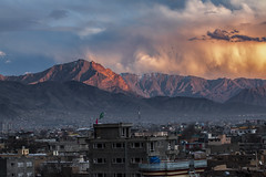 Mountain on Fire (mopics347) Tags: mountain fire outdoor clouds sunset orange yellow cloud city range mountains kite kites buildings flags green red blue snowcapped cityscape sky snow