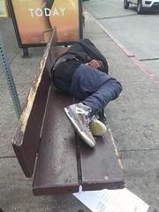 Sleeper at MUNI bus stop. Shattuck Avenue at Center Street, Berkeley, CA. (dgollub) Tags: berkeley muni