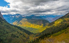 In the valley below (Photosuze) Tags: landscape sky clouds stormy valley autumn fall mountains dramatic glaciernationalpark trees montana