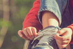 Kid (JM2LLC) Tags: girls females shoelace child tying oneperson outdoors sideview humanleg sportsshoe shoe clothing