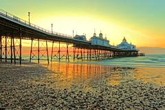 Eastbourne Pier at dawn (Geoff Henson) Tags: pier eastbourne dawn daybreak sunrise beach sea water building glow tide