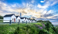 Northern Shore (PixStone) Tags: quebec canada landscape north america church sky clouds colors sunset house ocean shore grass light nature nikon d7100 bader pierre atlantic saint laurent cap forillon percé chat