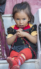 Girl in red tights (bag_lady) Tags: childhood girlinredtights buddhist ladakh india thikseymonastery buddhism monastery family