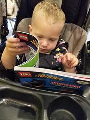 Serious reader (quinn.anya) Tags: paul toddler serious comicbook stroller