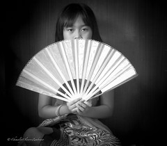 In the eyes of a child (stormymayen) Tags: girl eyes fan hands pretty face costume portrait range bw asian
