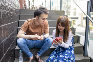 Young couple looking at smart phone screen together