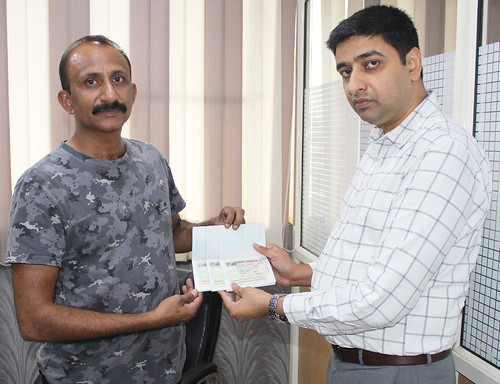 Gurvinder Kang (Director of West Highlander) handing over Canada Multiple Visitor Visa with family to Veenu Calvin Bhatty