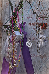 Offerings (Gary Burke.) Tags: cityofthedead cemetery stlouiscemetery1 basinstreet graveyard grave mausoleum crypt tomb architecture religious religion neworleans city louisiana south southern la tourism bigeasy crescentcity nola colorful color canon eos rebel t1i dslr klingon65 canoneosrebelt1i garyburke iberville marielaveau voodoo voodooqueen offerings voodoodoll travel wanderlust traveling citylife touristattraction citystyle historical history beads culture