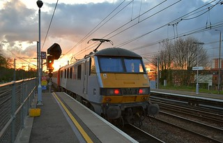 Class 90 Loco 90003 'Raedwald' propels the 18.30 London Liverpool St - Norwich away from Ipswich after its booked stop and into the setting Sun. 29 04 2015