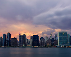 Manhattan skyline at dusk, Pride Day (johnny4eyes1) Tags: goldenhour landscape sunset cloudy sundown cityscape clouds longexposure bluehour cloudporn prideday newyorkcity longislandcity manhattan queens towers skyline skyscrapers storm