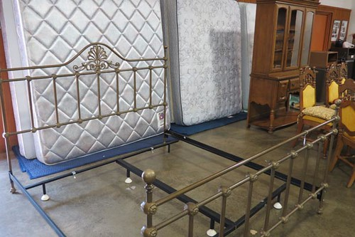 Ornate King Size Bed (front, $448.00) and Queen Size Bedding (behind, $123.20)