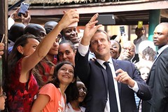 French president Emmanuel Macron poses for selfies during a visit to Louis Pasteur French high school on July 4, 2018, in Lagos.(Getty)