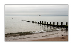Offshore (Explored) (Keith Gooderham) Tags: aberdeen beach seashore boat waves groyne somber forbidding tender oil industry scotland waiting kg180721279a1bweb1 copyrightgreenshotsphotography