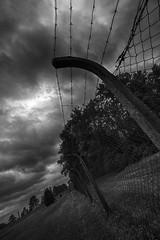 Take no prisoner (Sconsiderato) Tags: bianco black bw blackwhite biancoenero wire clouds cloud cloudy nuvole nuvoloso sconsiderato scuro scatto net lager ss war time canon eos