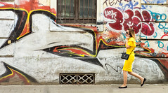 Lady In Yellow (TablinumCarlson) Tags: sofia bulgarien bulgaria durchgang eingang entry gate door leica summicron m240 m vitosha mountain fassade facade gelb yellow lady dame frau woman girl grafitti 90mm streetphotography street mobilephone handy telefon call phonecall telefonat