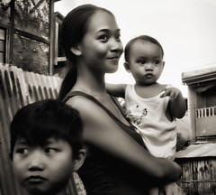 Showing Off Baby (Artypixall) Tags: philippines cebu baby woman youngboy children portraiturban sceneblack white
