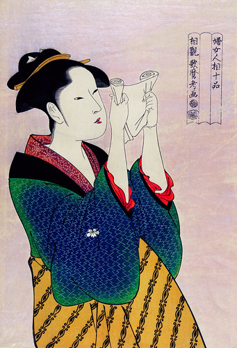Fumiyomu Onna by Utamaro Kitagawa (1753-1806), a traditional Japanese Ukyio-e style illustration of a Japanese woman portrait reading a letter. Digitally enhanced from our own original edition.