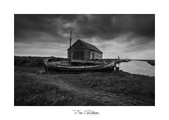 A last gasp (timgoodacre) Tags: wreck shipwreck boat boating boats ship ships rope mast building water estuary blackwhite blackandwhite monochrome mono clouds cloud sky landscape sea bay grass