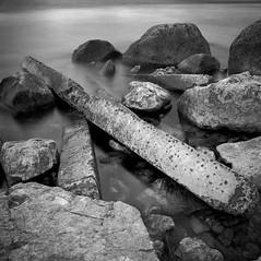 by the sea.. (Karl Johan) Tags: fujineopanacros fuji neopan acros 6x6 analog epsonv600 epson v600 ishootfilm limhamn skåne sweden sverige malmö hasselblad 500cm mf mediumformat outdoor film blackandwhite blackwhite rodinal bw bwfp monochrome classicblackwhite distagon504fle distagon 504 fle 120 longexposure ocean sea concrete stones