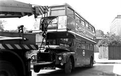 London transport RM1542  on tow  at Tower Hill 24/04/76. (Ledlon89) Tags: aec routemaster rm bus buses lt lte london londonbus londonbuses transport londontransport accident towerhill crash breakdowntruck 1970s 1976 damaged damage parkroyal manatador vintagebuses aecmilitant militant