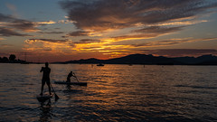 Locarno Beach Sunset (Sworldguy) Tags: sunset vancouver englishbay beach sand paddleboard kayak clouds orange skyscape recreational summer mountains park evening serene reflections dusk landscape shore sun britishcolumbia canada sonya73 wideangle seaside