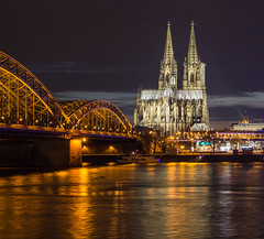 Cologne Reflections (Oleg S .) Tags: night blue color bridge church reflection germany architecture river water rhine cologne