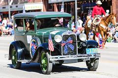 1930 Model A (wyojones) Tags: wyoming cody codystampedeparade ford modela 1930 elmerandbarbarabunn ribbons red whiteandblue fourthofjuly july4th parade car automobile clark flag usflag oldglory starspangledbanner wy usa wyojones