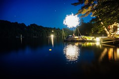 Canada Day in the cottage country of Ontario (beyondhue) Tags: lake ontario boat dock fireworks canada day celebration beyondhue reflection horizon dark night cottage