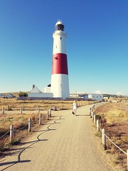 Walk this way... (Harleynik Rides Again.) Tags: harleynikridesagain phoneimage portland dorset lighthouse fence shadows explore