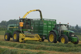 John Deere 7550 SPFH filling a Broughan Engineering Mega HiSpeed Trailer drawn by a John Deere 7530 Tractor