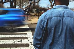 The Wait (kevingrallphotography) Tags: streetphotography street people life motion longexposure handheld crosswalk texting back perspective washingtondc washington dc canon canon50mm 50mm 50mmf10l f1 f10