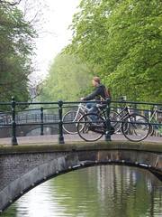 Reguliersgracht (yon_willis) Tags: amsterdam nederland noordholland holland grachtengordel 2014 thenetherlands canal northholland bicycle canalring cyclist bridge trees