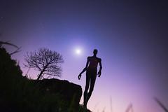 Nuss and Stars 2 (Notquiteahuman1) Tags: tree statue nuss stars sky dark colors colorfull evening moon moonlight grass ground human silhouette ghosts sigma1735mmf2840hsm outdoors estrela céu blue red purple starfigures