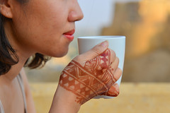 A woman drinks coffee in the morning (phuong.sg@gmail.com) Tags: adult aroma art asian attractive beautiful beauty body breakfast business city coffee colour cup drink female flowers food fun girl hand happy henna home human india indian jaisalmer life luxury marriage mehandi mehendi morning office old person rajasthan relax relaxation rich skyscraper smile spring summer sunny tattoo tea white window woman