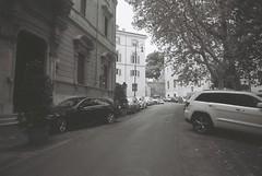 Roma (goodfella2459) Tags: nikon f4 af nikkor 50mm f14d lens bergger pancro 400 35mm blackandwhite film analog roma city streets tree road cars italy rome bwfp