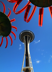 Needle in the Garden (studioferullo) Tags: architecture art beauty bright building colorful colourful colors colours contrast dark design detail edge light metal natural outdoor outside perspective pattern pretty scene sky study sunlight sunshine street texture tone world seattle washington space needle dancorson sonicbloom sculpture flower red blue curve tower