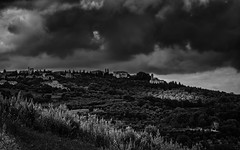 Storm Clouds Over Tuscany (Mike Schaffner) Tags: bw blackwhite blackandwhite buildings clouds italia monochrome montefollonico storm toscana trees tuscan tuscany village torritadisiena italy it