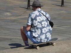 Passers-by III (m_artijn) Tags: skateboard board dude hat hipster passerby guy shirt bergen norway flower