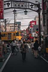 Yellow Train Crossing (Dave Schaefer) Tags: train city cityscape tokyo japan japanese asia asian daytime cloudy red orange yellow urban street streetphotography