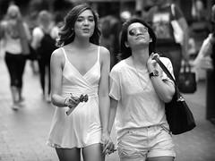 Together (Stuart Mac) Tags: couple together street women candid fuji xt2 56mm f12 mono dof london soho happy