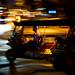Woman riding in a tuktuk in Bangkok's Chinatown