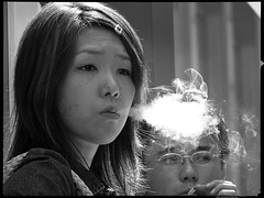 Whisper-of-Smoke (Danz in Tokyo) Tags: leica people bw white black girl japan japanese tokyo interestingness asia candid smoke puff smoking  nippon  fz30 exhale topv11 danz topv22 danzintokyo candidat70mm