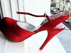 Shoes In Strange Places 4 (Lady Vervaine) Tags: street city red urban window crimson tag3 taggedout scarlet shoe tag2 alone tag1 single edge ledge balance heel ruby poised dontjump singular precarious windowledge theredshoes fairytalesdarkly