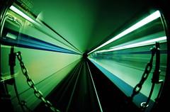 Subway Time Travels (candersonclick) Tags: longexposure chicago film train subway chains tracks slide fisheye velvia timetravel tunnels nikon16mm missinglens backofthetrain