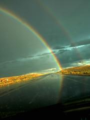 rainbow road (Mary Hockenbery (reddirtrose)) Tags: road light sky storm newmexico topf25 rain topv2222 golden rainbow topv555 topv333 topf75 pavement topv1111 topc50 topv999 roadtrip topf300 topv5555 50100fav topv777 topv3333 topv4444 topf100 topf250 topf200 topv6666 top20nm highway550