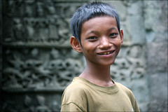 Khmer Smile: Da (mboogiedown) Tags: world poverty travel boy smile children asian temple hope la asia cambodia cambodian khmer child south culture east siem reap southeast ta cultural laa villager developing prohm theface kampuchea mapcambodia cambogia theravada travelforpeace bokehphotooftheday hopeforthefuture 1on1photooftheday camboge bokehsoniceseptember beatravelernotatourist itsallaboutthepeople reasontolearnkhmer bokehsoniceseptember8 dontjustseetheworldexperienceit experiencecambodia buddhistnations childrenoftaprom ifthephotographerisinterestedinthepeopleinfrontofhislensandifheiscompassionateitsalreadyalottheinstrumentisnotthecamerabutthephotographer~evearnold