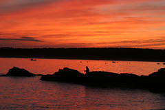 Fishing under fire (mikecullivan) Tags: ocean sunset clouds fishing maine 1025 firesky youshouldgeotagthis