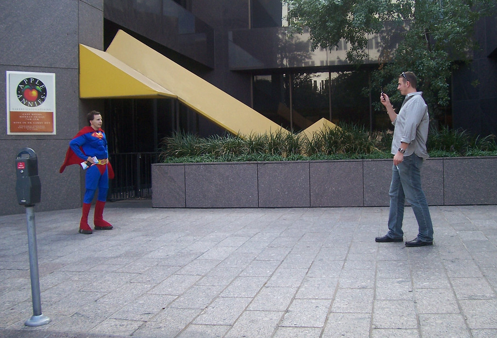 Cameraphonist interrupts Superman on an important mission