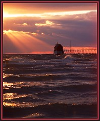 Grand Haven's Outer Lighthouse (Mrs. Terry) Tags: fab usa architecture mi reflections lighthouses footbridge framed quality sunsets lakemichigan lanterns sunrays grandriver soe catwalk photooftheday matted naturesfinest blueribbonwinner michiganlighthouse grandhavenmi greatphotographers supershot natureslight instantfave specnature abigfave karmafavorites nartureslight copyright2006byteresamforrest photosbyterry anawesomeshot colorphotoaward impressedbeauty superbmasterpiece beyondexcellence diamondclassphotographer flickrdiamond superhearts seasunclouds ysplix thatsclassy wwrusa 26june2007 coolestphotographers