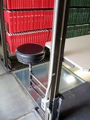 01.library-swing-stool (notanartist) Tags: red toronto library uoft glassfloor wakingcity teamflyingsquirrel